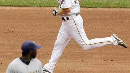 Brandon Moss Pirates outfielder Brandon Moss rounds the bases after hitting the game-winning walk-off home run as Brewers shortstop Bill Hall walks off the field in the ninth inning.