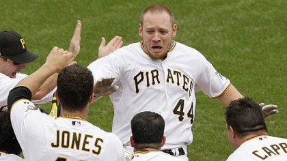 Brandon Moss Pirates outfielder Brandon Moss (44) is greeted by teammates as he arrives home after hitting a game-winning walk-off solo-home run off Brewers pitcher Mitch Stetter in the ninth inning.