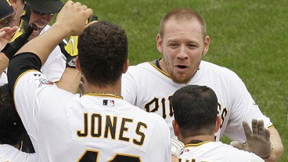 Brandon Moss Pirates outfielder Brandon Moss, top right, is greeted by teammates as he arrives home after hitting a game-winning walk-off solo home run off Brewers pitcher Mitch Stetter in the ninth inning.