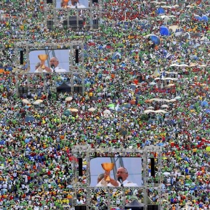 brazil Hundreds of thousands of people crowd Copacabana Beach in Rio de Janeiro as Pope Francis (on screens) celebrates Sunday the final Mass of his visit to Brazil. Throngs of pilgrims attending World Youth Day spent the night sleeping on the beach before Sunday's Mass.