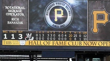 Brewers The scoreboard shows the historic final tally as the Brewers go through their post-victory line Thursday at PNC Park.