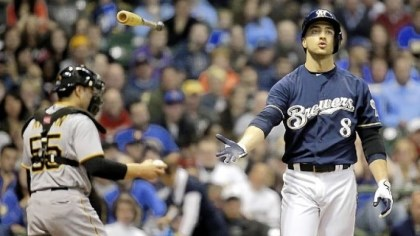 Brewers left fielder Ryan Braun Brewers left fielder Ryan Braun tosses his bat after being struck out by A.J. Burnett end the third inning Friday in Milwaukee. The Brewers won, 2-1.