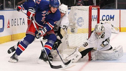 Brian Boyle, Jay McKee and Marc-Andre Fleury Rangers forward Brian Boyle has the puck poked away by Penguins goaltender Marc-Andre Fleury as defenseman Jay McKee gives chase.