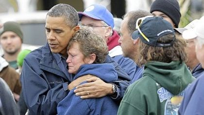 Brigantine, N.J. President Barack Obama embraces Donna Vanzant during a tour of a neighborhood effected by superstorm Sandy, in Brigantine, N.J.