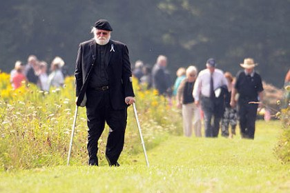 britton Rev. Paul Britton, who led the moment of silence today, walks the the impact area with other Flight 93 family members following the 12th anniversary Remembrance Service for Flight 93 at the National Memorial in Somerset County. Rev. Britton''s sister, Marion Britton, died in the crash.