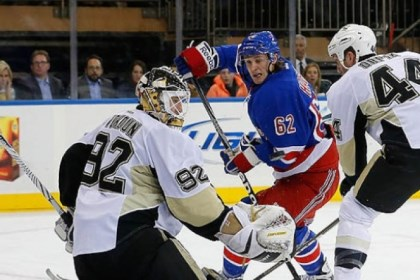 Brooks Orpik Brooks Orpik helps goalie Tomas Vokoun defend a shot by the Rangers' Carl Hagelin in a Jan. 31 game.