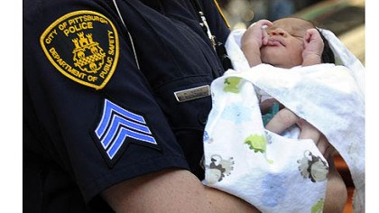 Bryce Coleman with officer Three-day-old Bryce Coleman is carried to an ambulance by a Pittsburgh police officer Thursday evening.