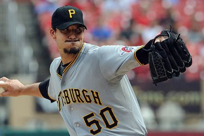 bucs1 Pirates starting pitcher Charlie Morton unloads against the Cardinals in the first inning at Busch Stadium in St. Louis.