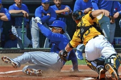 Bucs1 Anthony Gose of the Blue Jays slides in ahead of the tag of Pirates catcher Russell Martin Wednesday in Bradenton, Fla. The Pirates rallied to win in extra innings.