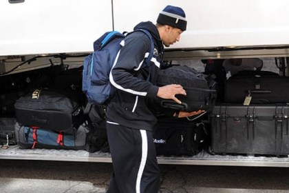CamWright Cameron Wright loads his luggage on a bus outside Petersen Events Center as the Pitt Panthers prepared to depart Tuesday for Salt Lake City.