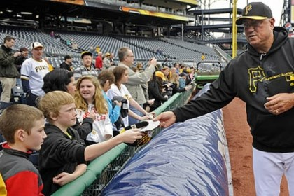clint Pirates manager Clint Hurdle signs autographs Sunday at PNC Park before the start of a workout open to the public.