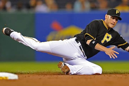 Clint Barmes The Pirates' Clint Barmes dives to stop a ball hit by the Padres' Rene Rivera in the fifth inning at PNC Park Monday night.