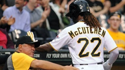Clint Hurdle and Andrew McCutchen Pirates manager Clint Hurdle gives a pat to Andrew McCutchen after he scored the only run of the game against the Cubs in the first inning.
