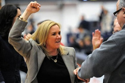 coach Duquesne coach Suzie McConnell-Serio celebrates after the Dukes' come-from-behind win Thursday at Palumbo Center.