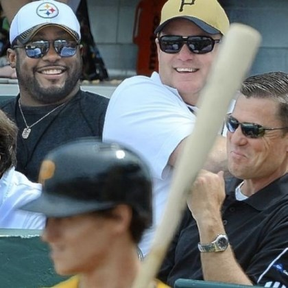 coaches Steelers coach Mike Tomlin and general manager Kevin Colbert joke with Pirates president Frank Coonelly at a Pirates exhibition game at McKechnie Field in Bradenton, Fla.