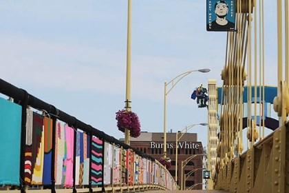 Colorful railing The Andy Warhol bridge swathed in knitted and crocheted panels of fabric for the Knit the Bridge art project. Friday is the last full day to see it before the installation is dismantled.