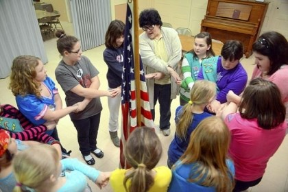 Connie Feda Connie Feda, right of the flag, leads members of her Girl Scout troop in a friendship circle, which represents the unbroken chain of friendship between Girl Scouts and Girl Guides worldwide. The troop includes a number of special-needs students, including Ms. Freda's daughter Hannah, second to the right of the leader, who has Down syndrome.
