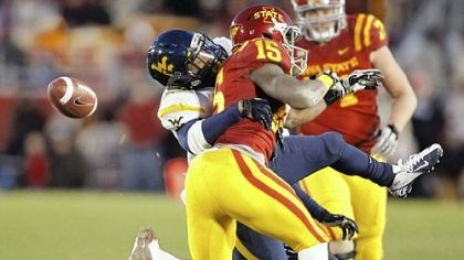 cook West Virginia safety Darwin Cook, left, breaks up a pass indented for Iowa State wide receiver Chris Young Friday in Ames, Iowa. West Virginia won, 31-24.