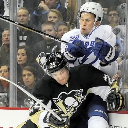 cooke Penguins forward Matt Cooke checks Lightning defenseman Keith Aulie into the boards at Consol Energy Center.