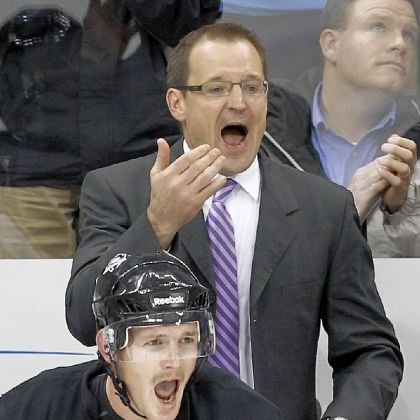 cookebylsma Penguins coach Dan Bylsma, top, and Matt Cooke try to get the attention of a player on the ice during the overtime period of a game against the New York Rangers.