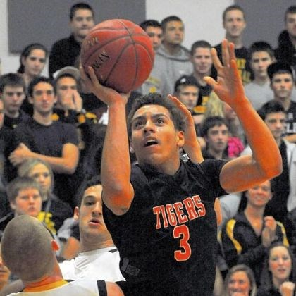 cottrill Elijah Cottrill of Beaver Falls drives toward the basket against Montour Thursday at Montour.
