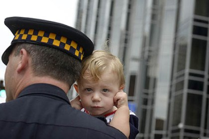 Craig Fleishauer Pittsburgh police detective Craig Fleishauer holds his 18-month-old son, Craig Paul, during a noisy Labor Day Parade Monday in Downtown Pittsburgh.