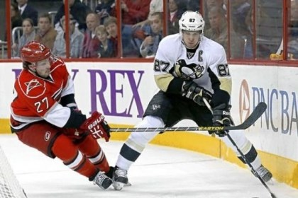 Crosby Sidney Crosby handles the puck behind the Hurricanes net.