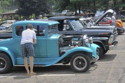 Cruise_8 An interested spectator looks at a 1931 Ford Model A owned by Ron Stetz of Zelienople at the car cruses held at St. Teresa of Avila church in Ross.