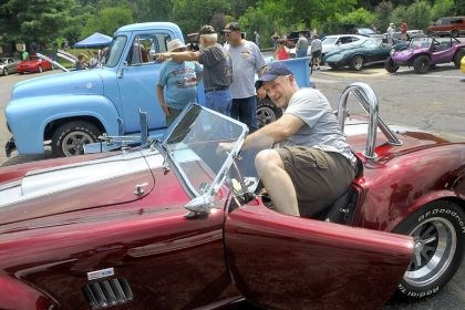Cruise_2 One of the draws at the car cruise July 21 at St. Teresa of Avila in Ross was lots of chrome.