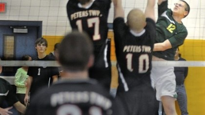 Deer Lakes Deer Lakes' Nick Roberts (No. 12), a senior outside hitter, tries to blast a shot past Peters Township defenders during a tournament match earlier this season.