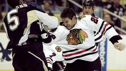 Deryk Engelland and Jake Dowell Blackhawks forward Jake Dowell fights Penguins defenseman Deryk Engelland.