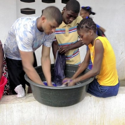 Devin Street Pitt receiver Devin Street, left, helps wash clothes at the EBAC orphanage.
