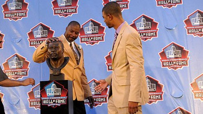 doleman Chris Doleman pats his bust as his son Evan Doleman stands by after the former Pitt standout was welcomed into the Pro Football Hall of Fame Saturday night in Canton, Ohio.