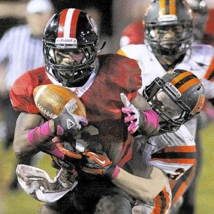Dravon Henry Aliquippa's Dravon Henry picks up a first down against Beaver Falls last week.