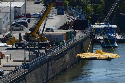 ducky prep lower A crew on the grounds of the the Alcosan treatment facility lowers the deflated rubber duck onto the Ohio River on Friday