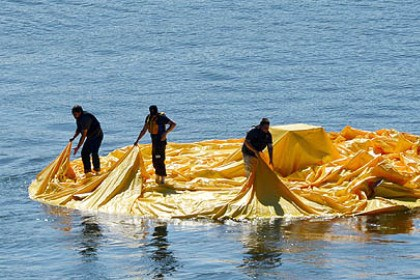 ducky prep starting A crew prepares to inflate the 40-foot rubber duck on the Ohio River near the McKees Rocks Bridge on Friday.