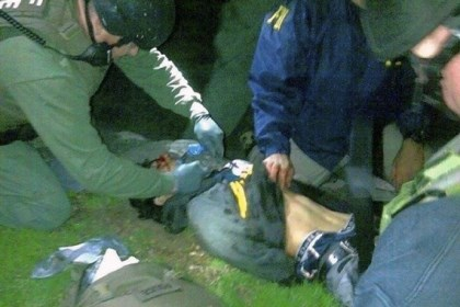 Dzhokhar Tsarnaev In this photo authenticated by a member of the Bureau of Alcohol, Tobacco, Firearms and Explosives, ATF and FBI agents check suspect Dzhokhar Tsarnaev for explosives and give him medical attention after he was apprehended in Watertown, Mass., Friday night.