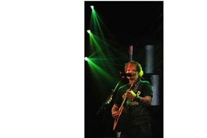 Ed Sheeran vertical Ed Sheeran, in Pittsburgh on Jan. 28, is essentially a folk singer who puts poetry to an acoustic guitar.