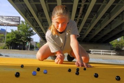 Emily Cavacini Emily Cavacini, 10, of Shaler, the Allegheny County marbles champion, practices at a ring under the Bloomfield Bridge in Pittsburgh, as she prepares for the June 17 National Marble Championship in Wildwood, NJ.