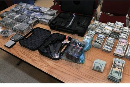 Evidence Evidence from a drug bust sits in the Swissvale Police Station. Cocaine and marijuana with a street value of more than $2 million as well as a stolen gun and more than $100,000 cash were seized in Penn Hills.