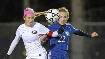 Fabean Greensburg Central Catholic's Malea Fabean, left, jostles with Shady Side's Tori Winter during PIAA semifinal match.