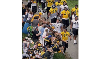 Fans at camp Fans reach out to touch Ben Roethlisberger and Troy Polamalu before camp begins.