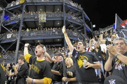 Fans cheer for the Pirates The crowd of 40,487, the largest paid attendance in the history of PNC Park, cheered wildly for the Pirates.