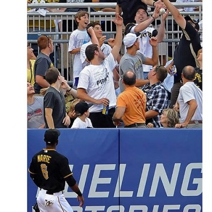 Fans grab a home run ball Fans grab a home run ball hit by the Rockies' Troy Tulowitzki off the Pirates' Gerrit Cole in the second inning at PNC Park Friday night.