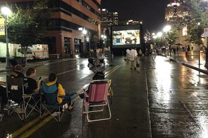 few faithful fans A few faithful fans stay through the rain to watch the game on the big screen outside PNC Park.