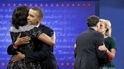 final debate First Lady Michelle Obama, left, hugs President Barack Obama as Ann Romney, right, hugs Republican presidential candidate Mitt Romney at the end of the third and final presidential debate Monday at Lynn University in Boca Raton, Fla.