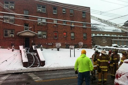 Fire out Firefighters survey the scene of apartment building fire this morning on North Negley Avenue.