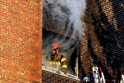 firefighter smoke fire shadyside A Pittsburgh firefighter comes to a fifth floor window at the Amberson Apartments in Shadyside.
