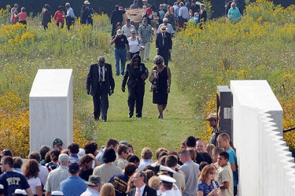 flight 93 Family members return to the Ceremonial Gate after visiting the impact area following the 12th anniversary Remembrance Service for Flight 93 at the National Memorial in Somerset County.