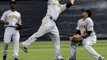 Freddy Sanchez Pirates second baseman Freddy Sanchez, center, catches a shallow pop fly off the bat of Twins infielder Brendan Harris under the watch of center fielder Andrew McCutchen, left, and right fielder Delwyn Young, right, in the first inning last night's game.